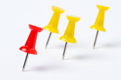 Red and Yellow Pushpins. On White Paper. Shallow Depth of Field Royalty Free Stock Photography