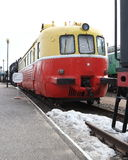 Red and yellow railbus. Front and along right view Royalty Free Stock Photography