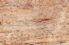 Red and yellow rocky mountain cliff natural texture wall. Background stock photos