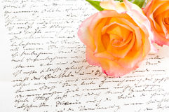 Red yellow rose over a hand written letter Stock Photos