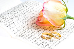 Red yellow rose, ring over a hand written letter Stock Image