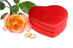 Red yellow rose rings heart shape box Stock Photo