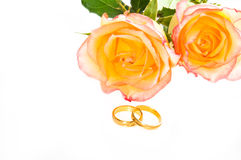 Red yellow roses and golden ring over white Royalty Free Stock Photos