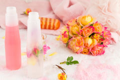 Red and yellow roses with rose massage oil Stock Photo