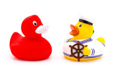 Red and yellow rubber bath ducks. Isolated on white Stock Images