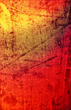 Red and yellow rusty metal tin background Stock Images
