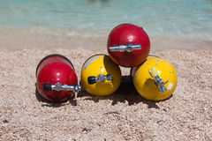Red and Yellow Scuba Oxygen Tanks for Divers on a Beach Royalty Free Stock Image