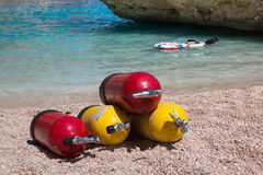 Red and Yellow Scuba Oxygen Tanks for Divers on a Beach. Colorful Scuba Oxygen Tanks for Divers on a Beach royalty free stock images
