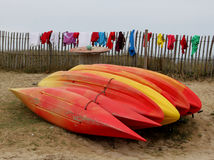 Red and Yellow sea kayaks Stock Photos