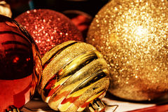 Red and yellow shimmering christmas baubles, retro photo filter. Red and yellow shimmering christmas baubles. Symbolic objects. Xmas decoration. Retro photo royalty free stock photo