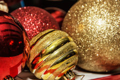Red and yellow shimmering christmas baubles Royalty Free Stock Images