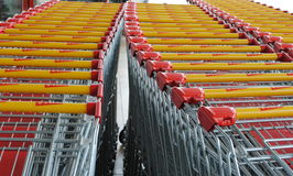 Red and yellow shopping trolleys Royalty Free Stock Images
