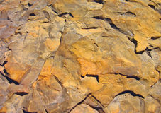 Red-yellow stone Stock Images