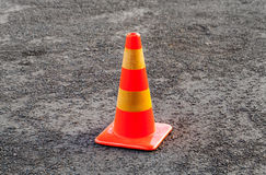 Red and yellow striped warning cone Royalty Free Stock Images