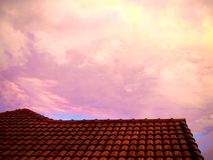 Red cloudy sky in the morning, concrete roof slope background Royalty Free Stock Photos