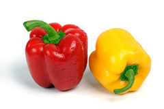 Red and yellow sweet pepper. Red and yellow sweet pepper on a white background Royalty Free Stock Images