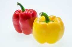 Red and yellow sweet pepper isolated on white background Royalty Free Stock Photography