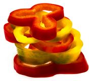 Red and yellow sweet pepper slices isolated on white background Royalty Free Stock Photos