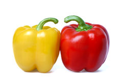 Red and yellow sweet peppers isolated Royalty Free Stock Photography