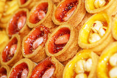 Red and yellow tartlets Stock Photos