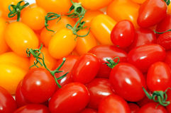Red and yellow tomatoes cherry as background Royalty Free Stock Photos