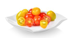 Fresh red and yellow tomatoes in  plate on white background. Red and yellow tomatoes in  plate on white background Stock Photos