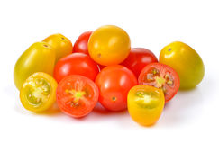 Red and yellow tomatoes on white background. Red and yellow tomatoes on a white background stock photography