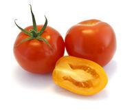 Red and yellow tomatoes on white background Stock Photos