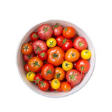 Red and yellow tomatoes on a white background Royalty Free Stock Image