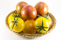 Red and yellow tomatoes in wicker oval shape Royalty Free Stock Photos