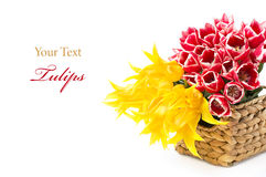 Red and yellow tulips in a basket stock photos