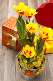 It is red yellow tulips and gift boxes Royalty Free Stock Images