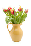 Red and yellow tulips in a yellow vase isolated Stock Photography