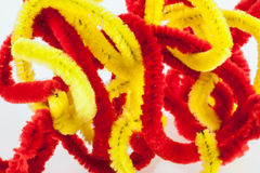 Red and yellow twisted pipe cleaners Royalty Free Stock Image