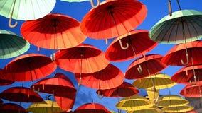 Umbrella heap on blue sky, enternainment details,. Red and yellow umbrella heap on blue sky in sunny day stock video