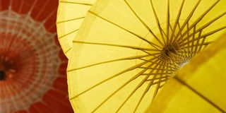 Red and yellow umbrellas with national Thai patterns. Factory in Chiang Mai Royalty Free Stock Photos