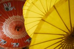 Red and yellow umbrellas with national Thai patterns. Factory in Chiang Mai Stock Image