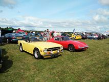 Red and yellow vintage car showing outdoor. Triumph car. Vintage car show outdoor at Northumberland Wings & Wheels festival at Eshott Airfield north of Morpeth stock images