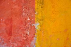 Red and yellow colors on a vintage wall Stock Photos