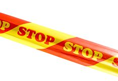 Warning tape with STOP sign isolated on white background. Red and yellow warning tape with STOP sign isolated on white background stock photos