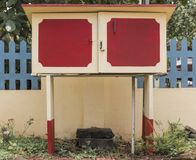 Red And Yellow Water Pump Cabin royalty free stock photo