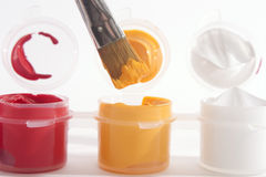 Red Yellow White Acrylic Paints and Paintbrush Royalty Free Stock Image