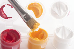 Red Yellow White Acrylic Paints and Paintbrush Royalty Free Stock Photography
