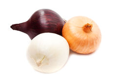 Red, yellow and white onion. On a white background close up Royalty Free Stock Images