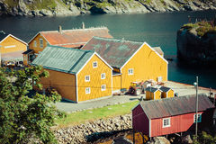 Red and yellow wooden fishing cabins in Norway Stock Photos