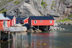 Red and yellow wooden fishing cabins in Norway Royalty Free Stock Photos