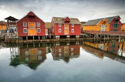 Red and yellow wooden houses in Norwegian village. Red and yellow wooden houses in Norwegian fishing village. Rorvik, Norway royalty free stock image
