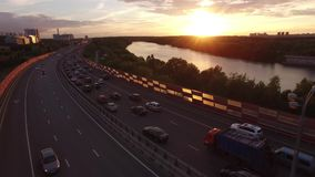 Red Zhivopisny Bridge in Moscow city, Unique quadcopter views. Eric sunset, Road Traffic. From above. Best aerial view. From above 4k stock video footage