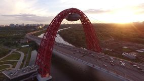 Red Zhivopisny Bridge in Moscow city, Unique quadcopter views. Eric sunset, Road Traffic. From above. Best aerial view From above 4k stock footage