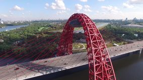 Red Zhivopisny Bridge in Moscow city, Unique quadcopter views. Sunny day, Road Traffic. From above. Best aerial view Red Zhivopisny Bridge From above stock video footage